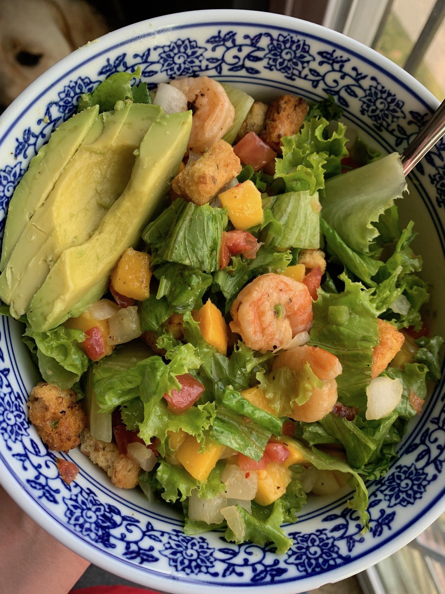 mango shrimp salad in a blue and white bowl